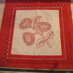 Redwork panel framed for scrap booking page