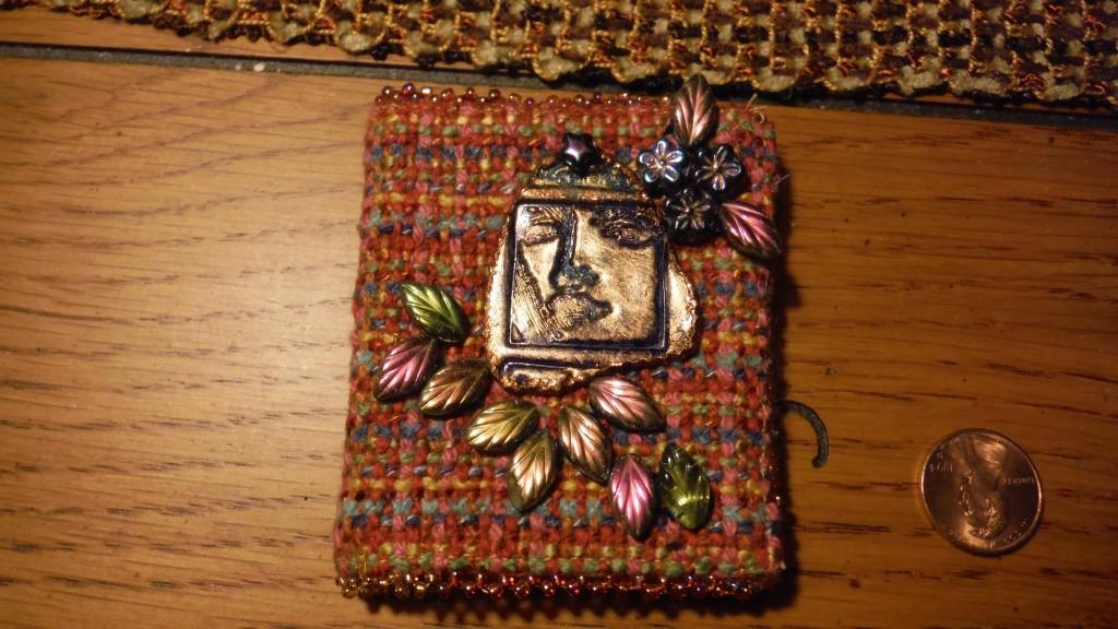 Hand woven needle book